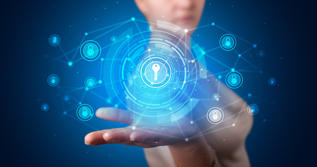 Young person holding hologram screen displaying security infomartions Stok Fotoğraf