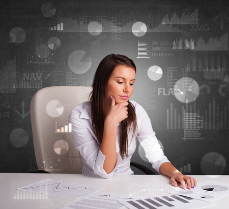 Young manager at the office making report and statistics with blackboard background