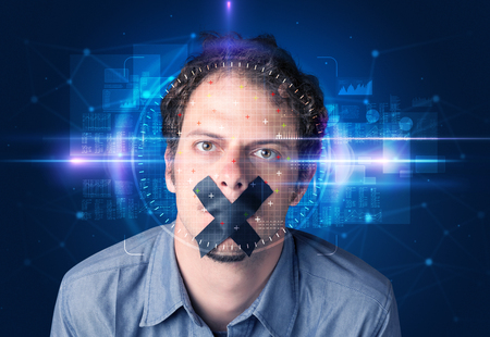 Facial recognition system. Young man on blue background
