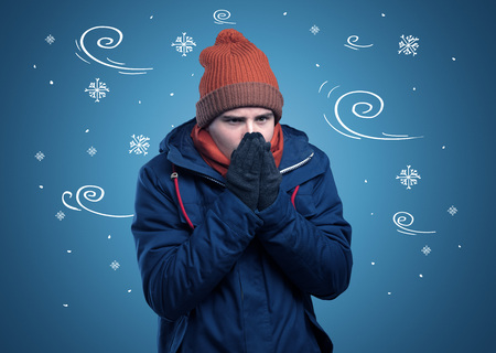 Young hipster frozen boy with doodled snowflakes and windy concept 版權商用圖片