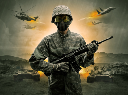 Armed soldier with sniper in the middle of a war Stock Photo