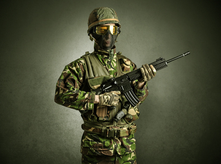 Soldier agent in a dark room with arms on his hand and gas mask