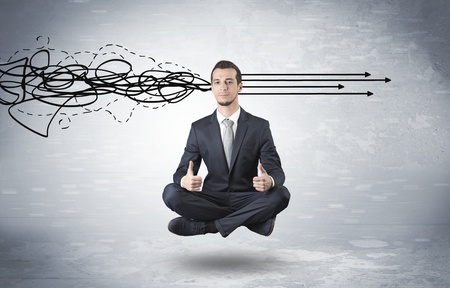 Businessman levitates in yoga position and systematize with thinking concept