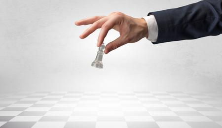 Big elegant hand taking his next step on chess game Фото со стока - 123350371