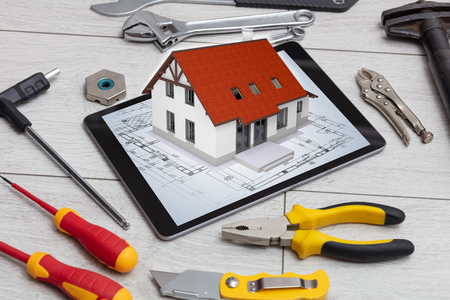 Tablet with construction tools and 3d home plan concept Stock Photo