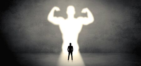 Businessman standing and dreaming about a strong superhero Imagens