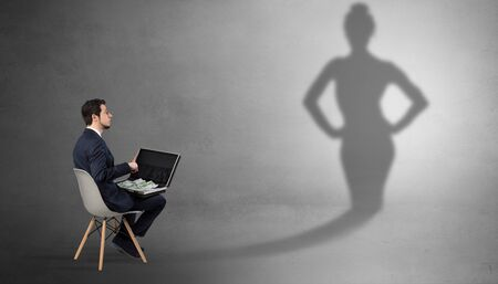 Rich businessman staying and offering stuffs to a pretty shadow woman Stock Photo