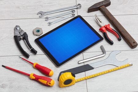 Household tools and tablet with grid screen concept Stok Fotoğraf