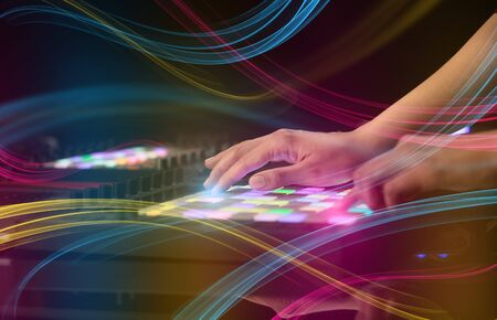 Hand mixing music on midi controller with colorful vibe concept Stock Photo