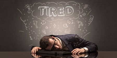 Young elegant businessman fell asleep at his workplace with doodled idea, sleep and tired concept Foto de archivo
