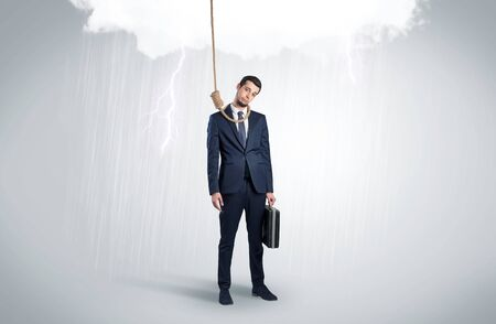 Concept of stressed businessman at work with thunderstorm above him