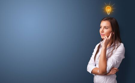 Young person looking for new idea with lighting bulb concept Banco de Imagens