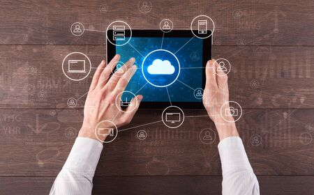 Hand touching tablet with cloud computing and online storage concept 写真素材