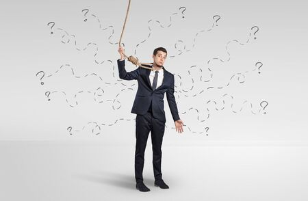 Concept of stressed businessman with question marks around him Reklamní fotografie