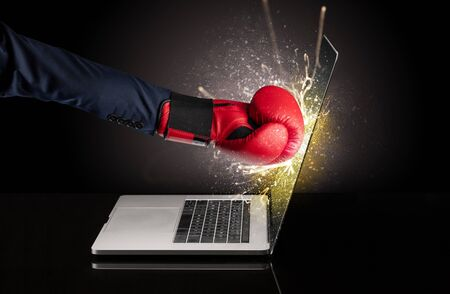 Strong arm boxing laptop screen strongly Stock Photo