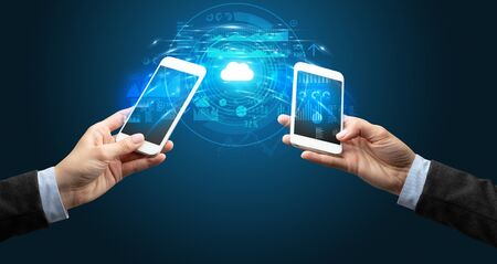 Two mobile phones syncing through the cloud