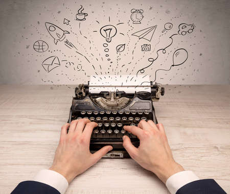Typewriter with doodles, idea, message, plane, car balloon social media concept Stockfoto