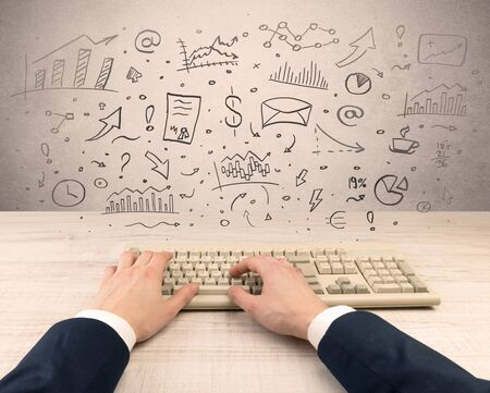 First person view of an elegant businessman hand typing with doodle report and chart concept Stockfoto