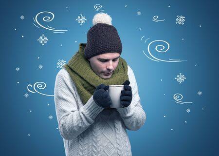 Young hipster frozen boy with doodled snowflakes and windy concept Stockfoto