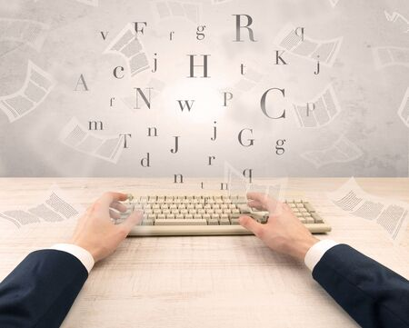 First person view of an elegant businessman hand typing with fluttering papers around