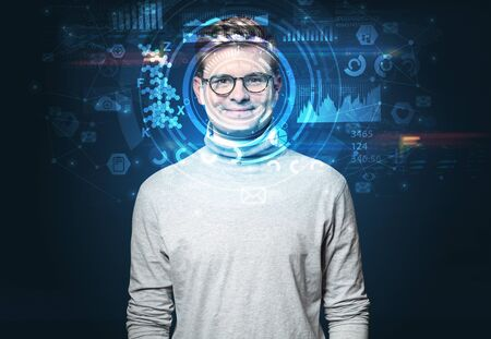 Facial recognition system. Young man on dark background, face recognition concept