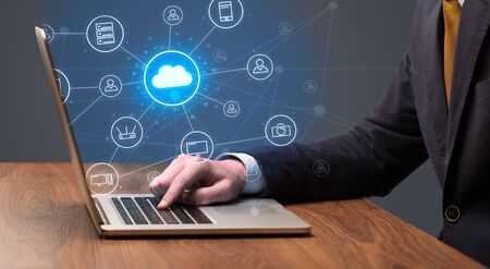 Businessman hand typing with cloud technology system and office symbol concept Stock Photo