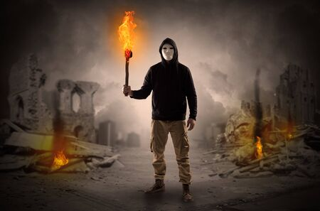 Destroyed place after a catastrophe with man and burning flambeau concept Stock Photo
