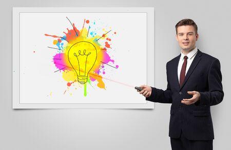 Man with laser pointer presenting innovative idea