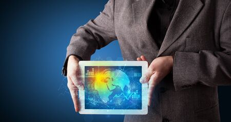 Hand holding tablet with global database concept