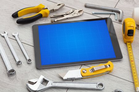 Household tools and tablet with grid screen concept