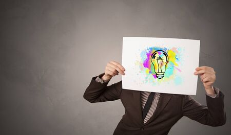 Person holding a paper with a drawn colorful idea concept