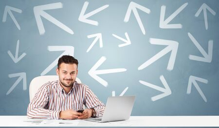 Business person sitting at desk with different direction concept Banco de Imagens
