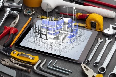 Tablet with construction tools and 3d house plan concept Imagens