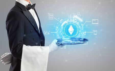 Waiter serving on a tray cryptocurrency and mining concept Imagens