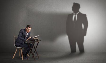 Shadow threatening hard worker man who is afraid 写真素材