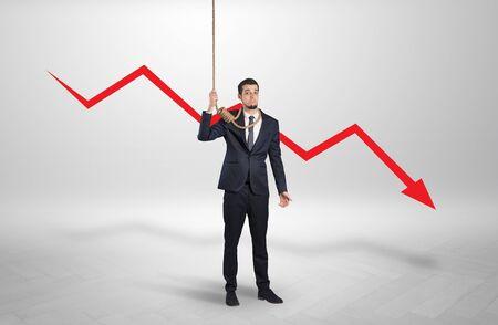 Desperate young businessman with decreasing bankruptcy concept Reklamní fotografie
