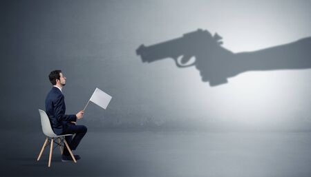 Small businessman staying and offering stuffs for an armed shadow hand