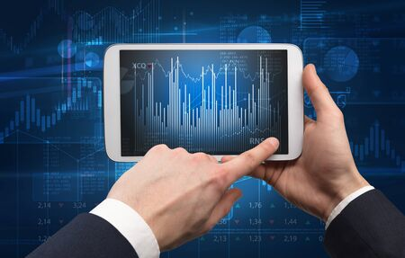 First person hand using tablet and checking financial report on cloud computing system Banco de Imagens