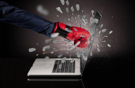 Strong male hand breaks laptop screen 版權商用圖片