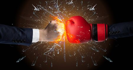 Two hands fighting and breaking a glass into small pieces Stock fotó