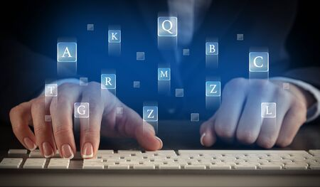 Business woman typing on keyboard with letters around Stok Fotoğraf