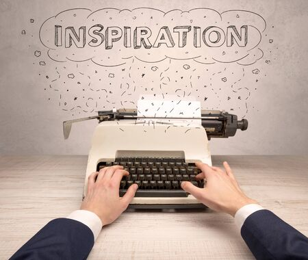 First person perspective hand writing on typewriter with cloud message concept