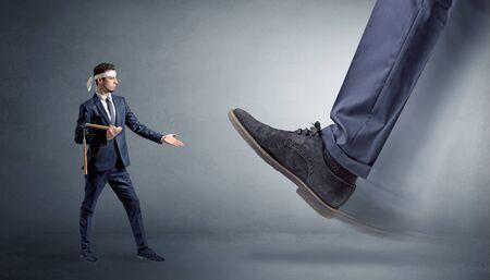 Big foot treading small young karate man