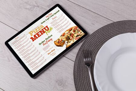 Non stop order online pizza menu with tableware concept 版權商用圖片