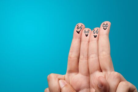 Happy face fingers hug each other Фото со стока