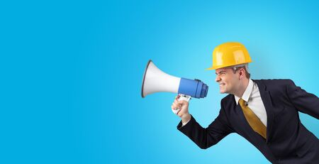 Young architect constructor yelling with megaphone and copyspace Standard-Bild - 129156441