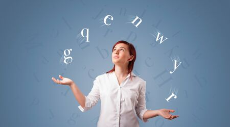 Young student juggle with letters Banque d'images