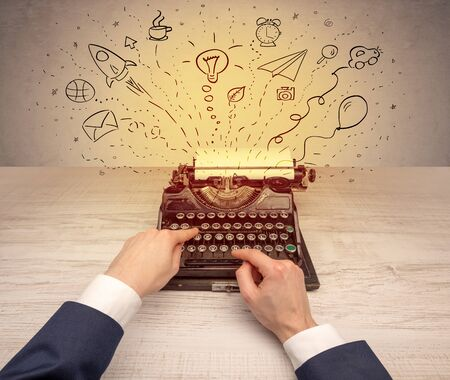 Typewriter with doodles, idea, message, plane, car balloon social media concept 版權商用圖片