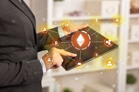 Business woman using tablet with cryptocurrency bitcoin link network and online concept