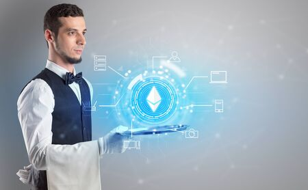Waiter serving on a tray cryptocurrency and mining concept Foto de archivo - 129664893